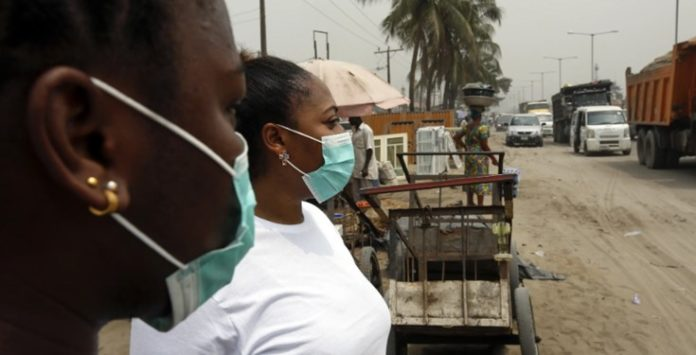 Pandemonium-as-Chinese-woman-falls-starts-vomiting-at-Nigerian-Immigration-Services-in-Lagos